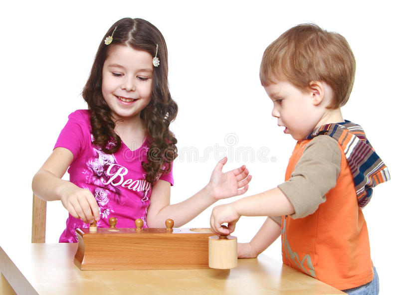 Brother and sister playing at the table royalty free stock photos