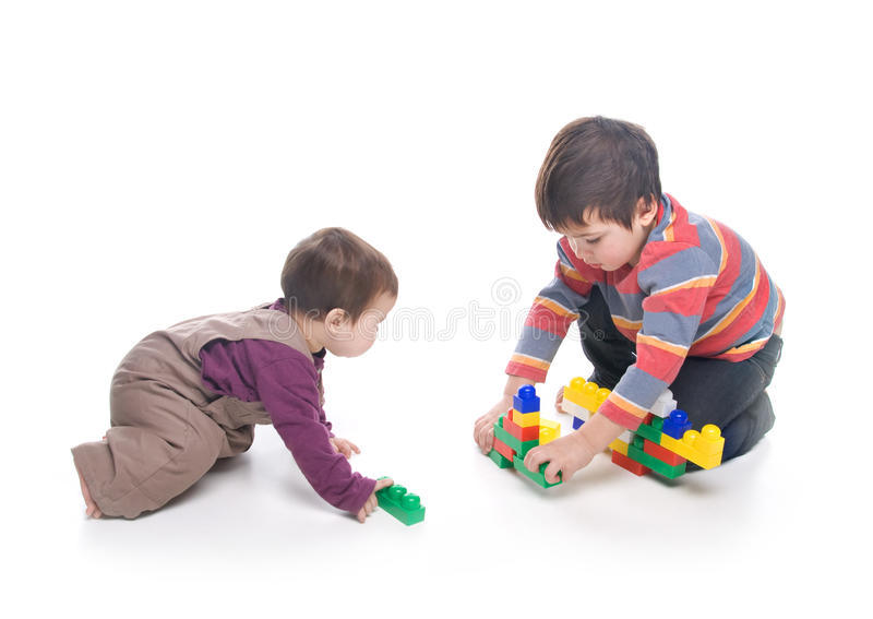 Brother and sister playing together stock image