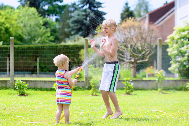Child Water Naked Playing - a Royalty Free Stock Photo
