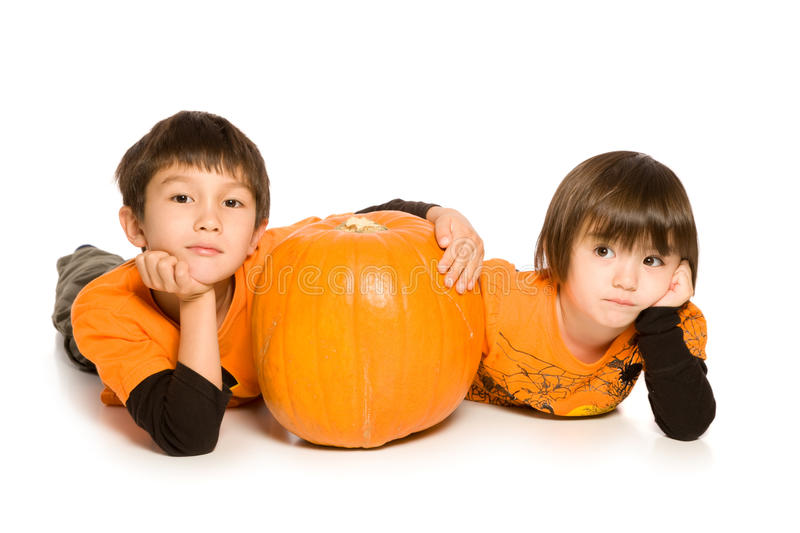 Brother and Sister with Pumpkin stock photo