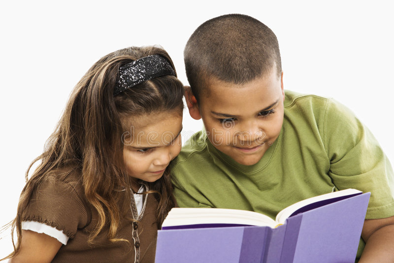 Brother and sister reading book. stock photography