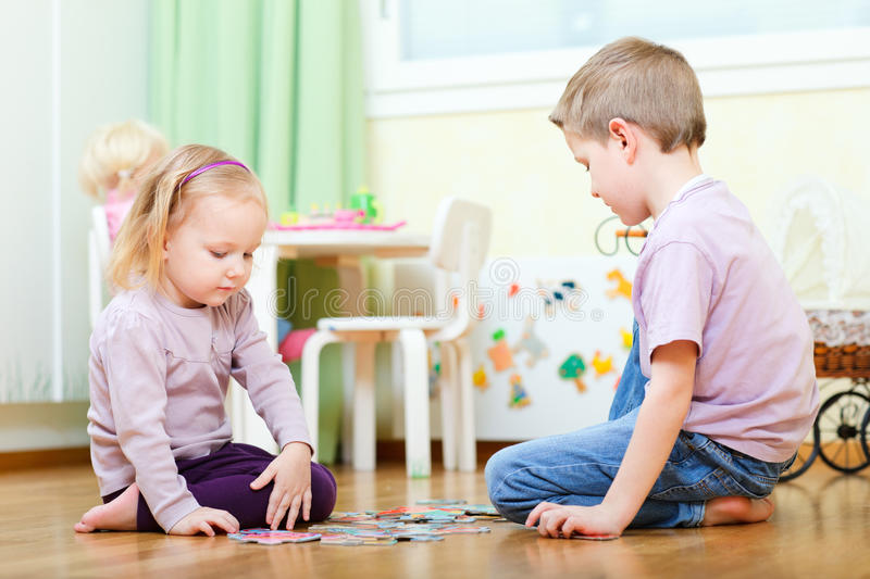 Download Brother And Sister Solving Puzzle Stock Image - Image: 18914467