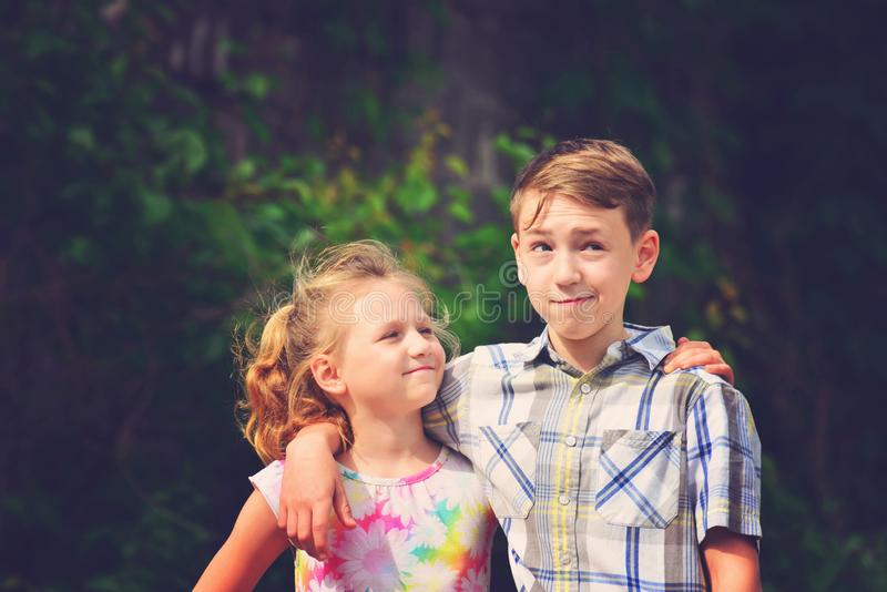 Brother and sister stand in an embrace in the park on the street and look at each other. The concept of happiness, family, love,. Unity and joy royalty free stock photos