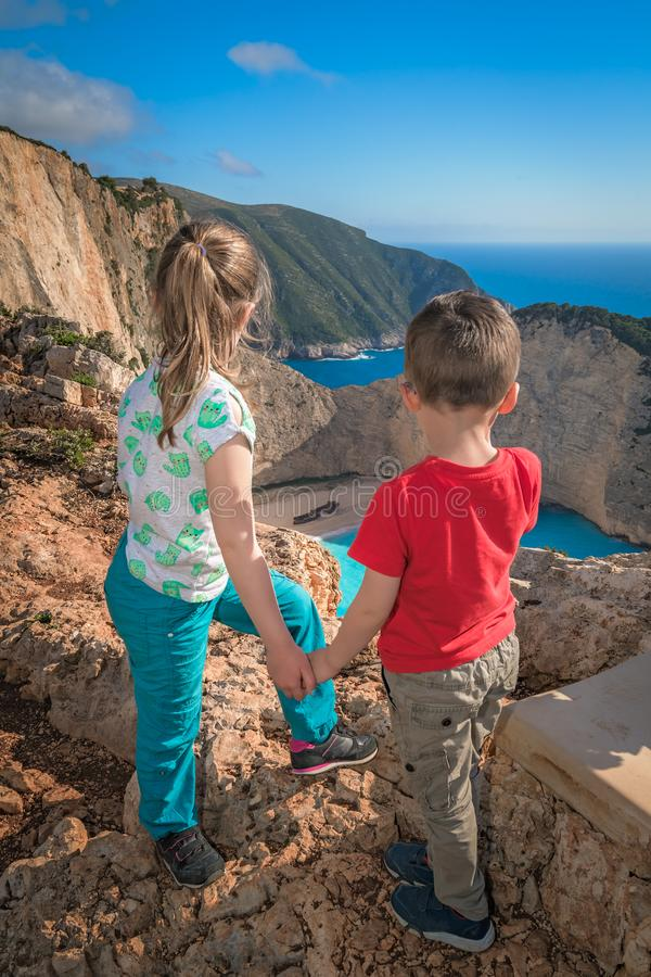 Children admiring stunning Shipwreck Cove. Brother and sister standing together on the viewpoint and admiring stunning view of the cliffs in Shipwreck Cove royalty free stock images