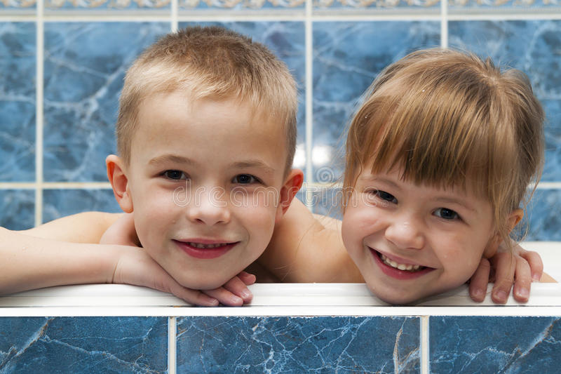 Brother and sister taking a bubble bath. Little boy and girl playing. Healthcare and hygiene concept. Brother and sister taking a bubble bath. Little boy and stock photography