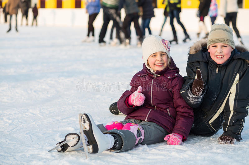 Brother and sister together fell while skating. And doing a thumbs up royalty free stock photos