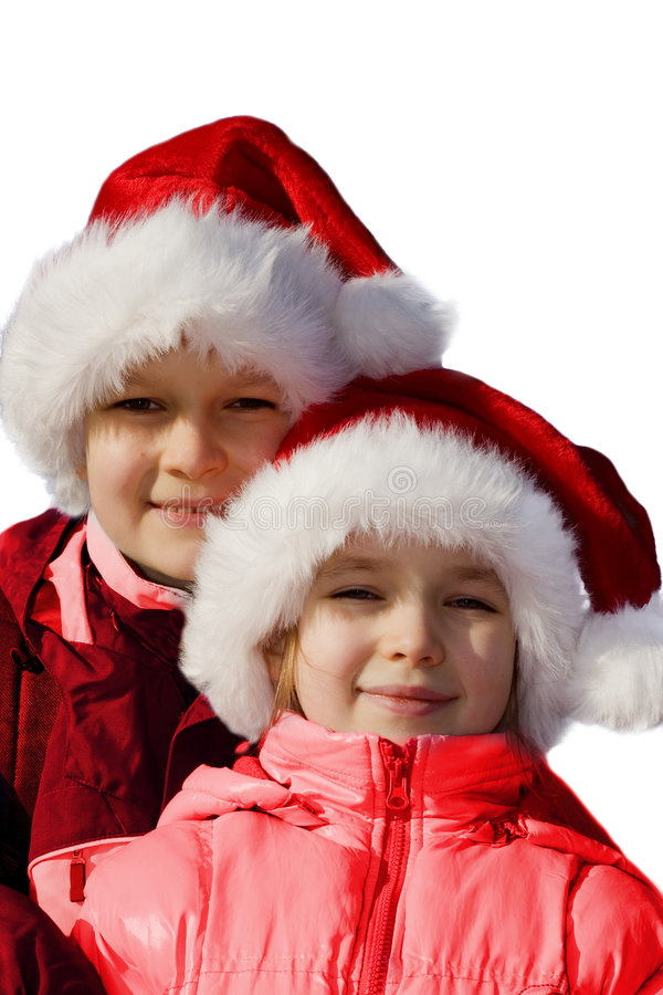 Brother and sister wearing Santa hats. stock photos