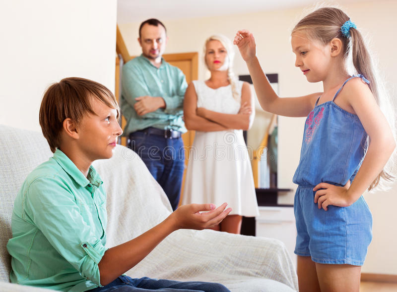 Brother is talking to her sister crying stock images