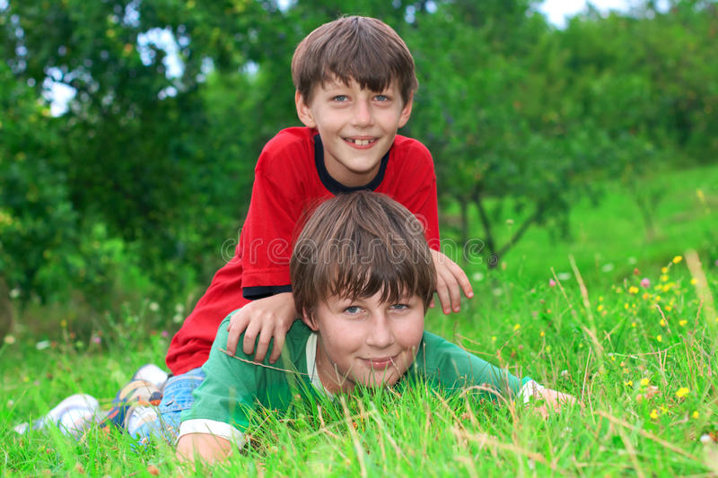 Brothers. Fun outdoor on grass royalty free stock photo