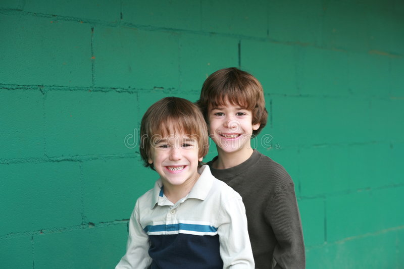 Brothers. Sitting with a Green Background stock photos