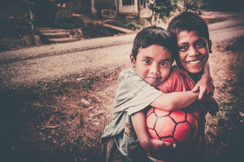 Brothers with a ball royalty free stock image