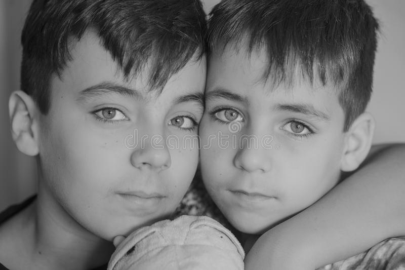Brothers. Black and white Brothers portrait stock images