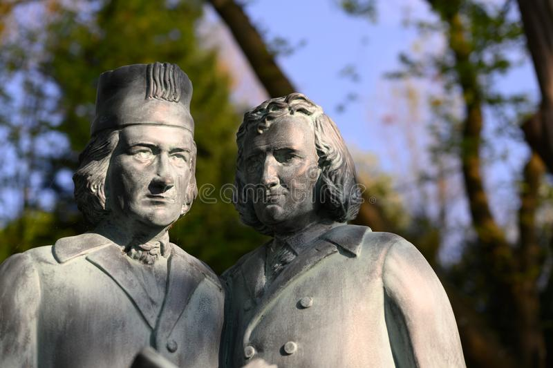 The Brothers Grimm as statues in a park. The storyteller Grimm shot in a park stock photos