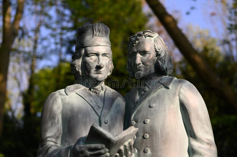 The Brothers Grimm as statues in a park. The storyteller Grimm shot in a park stock image