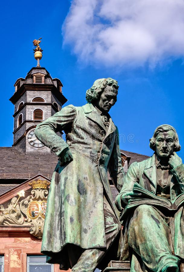 Brothers Grimm in Hanau, Germany. Brothers Grimm looking down at the market square, Hanau, Germany stock image