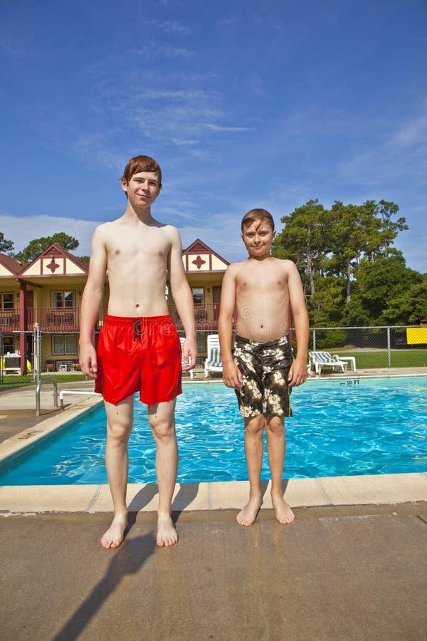 Brothers having fun at the pool royalty free stock photos