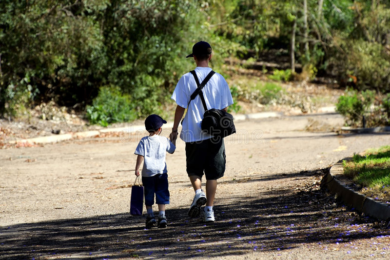 Brothers heading home royalty free stock image