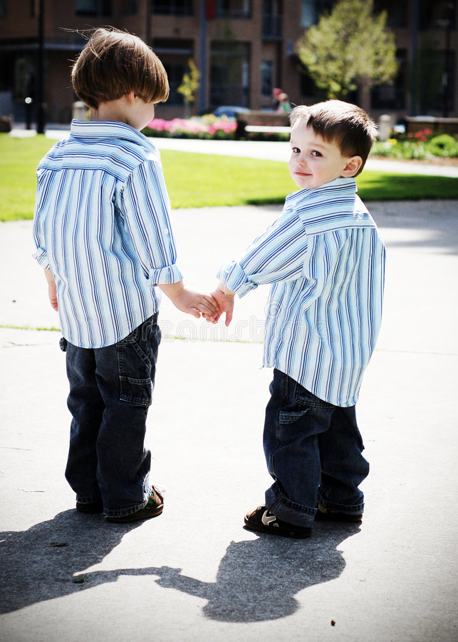 Brothers Holding Hands royalty free stock photos