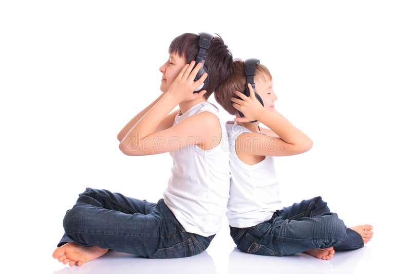 Brothers listening to music royalty free stock photo