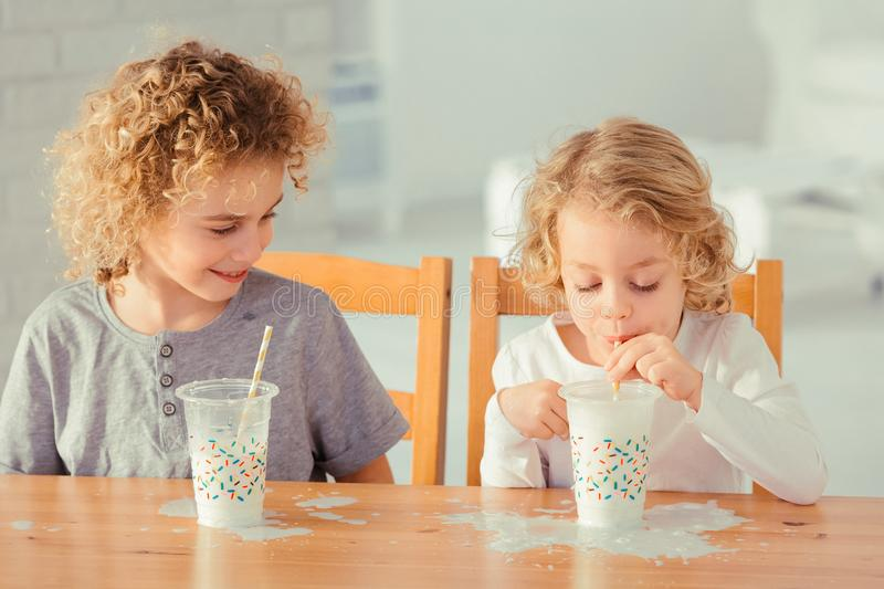 Brothers making mess in kitchen stock images