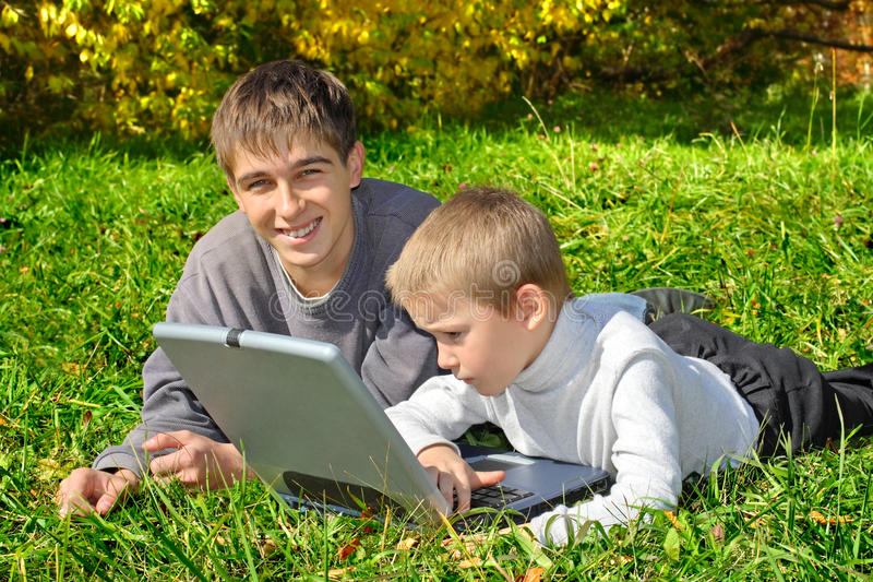 Brothers with notebook
