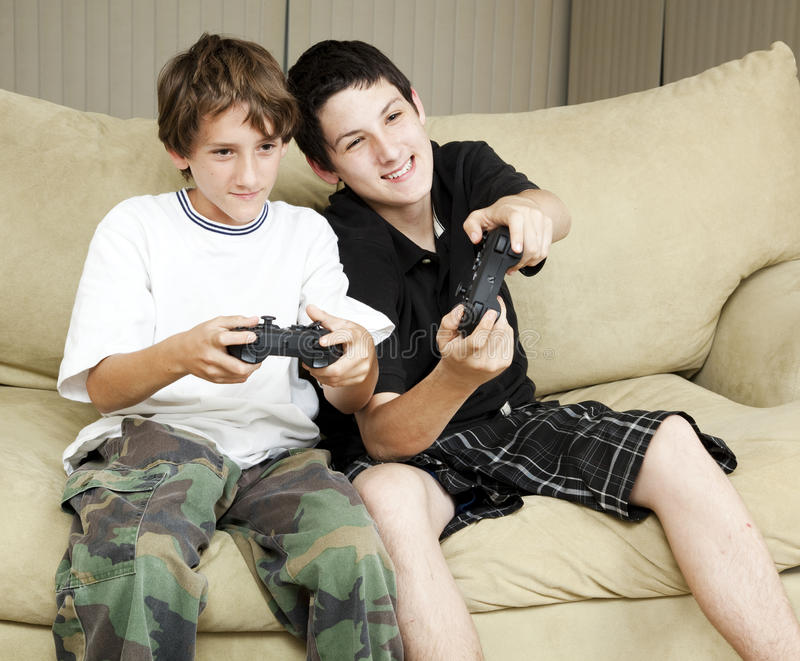 Brothers Play Video Games royalty free stock images
