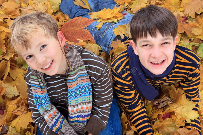 Brothers playing in Autumn stock photos
