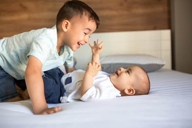 Brothers playing on the couch. Bonding and taking care of each other royalty free stock photo