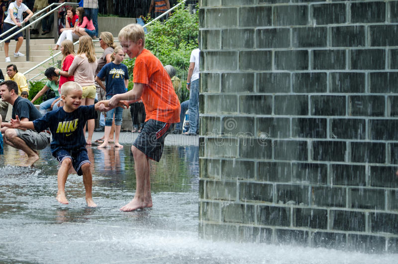 Download Brothers Playing In The Crown Fountain Editorial Photo - Image: 26696931