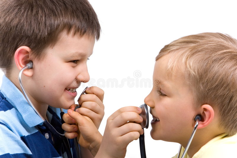 Brothers Playing With Stethoscopes. Two young brothers with stethoscopes facing each other in profile, playfully holding up the ends to each other's mouths to royalty free stock photos