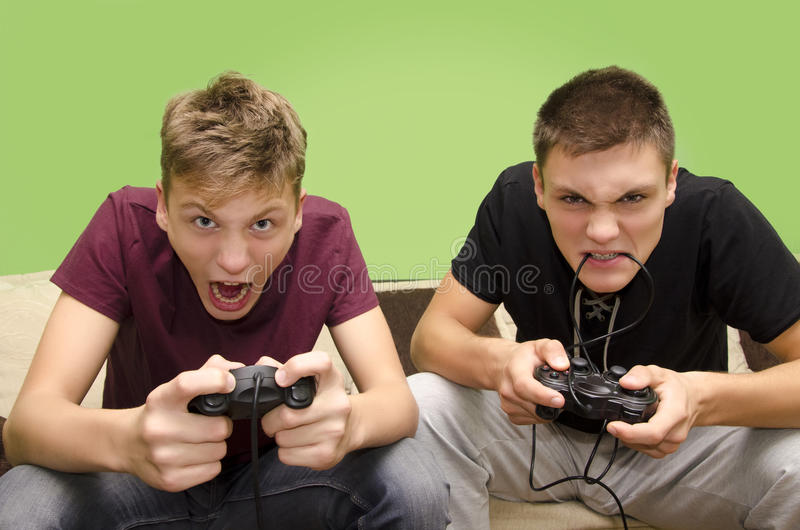 Brothers playing video games funny selective focus on younger brother royalty free stock photos