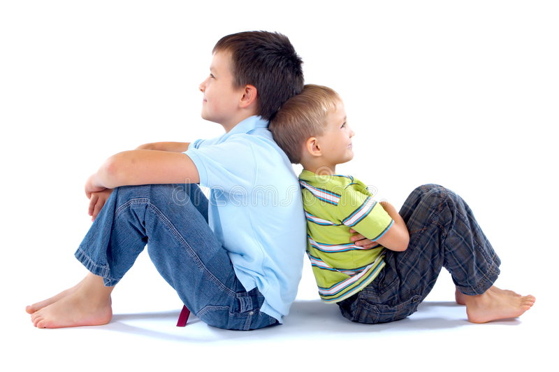 Brothers seated back to back royalty free stock photos
