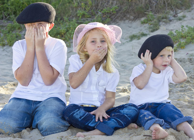 Brothers and sister on the beach
