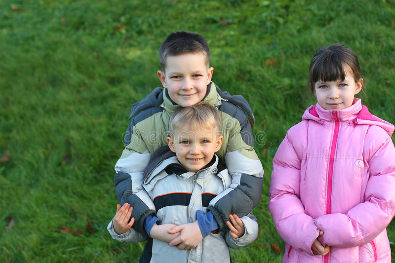 Brothers and Sister in a Field royalty free stock photography