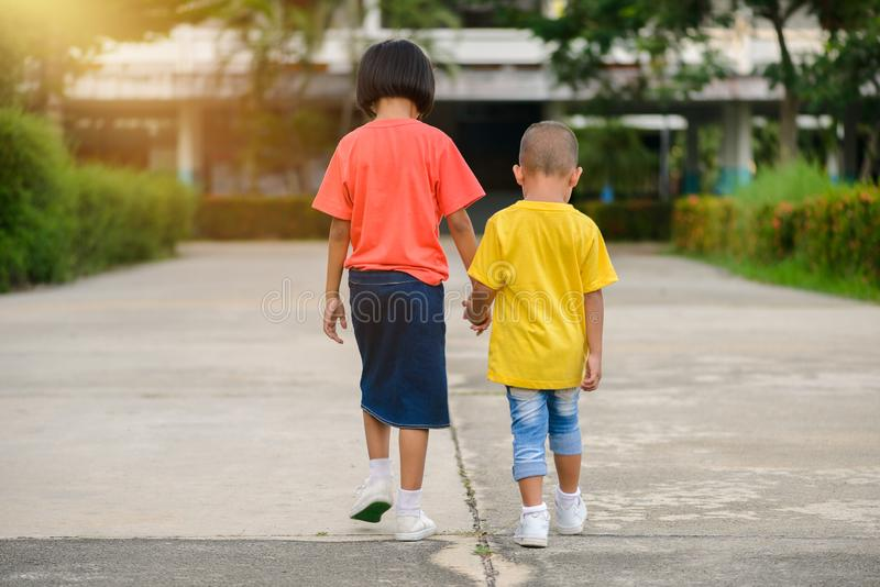 Brothers and sisters walk hand in hand. Little asian Brothers and sisters walk hand in hand. love family concepts royalty free stock photography