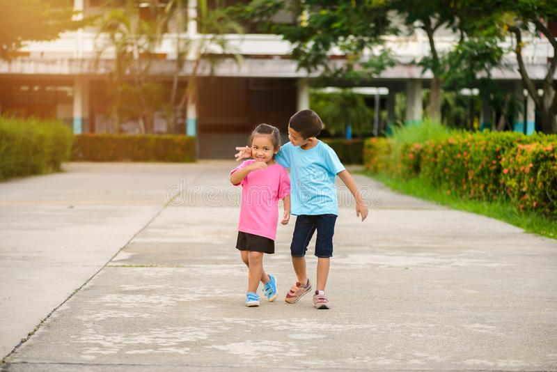 Brothers and sisters walk hand in hand. Little asian Brothers and sisters walk hand in hand. love family concepts royalty free stock photos