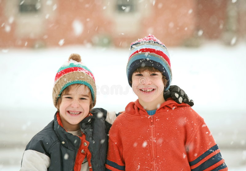 Brothers on a Snowy Day stock images