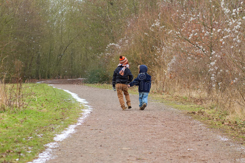 Brothers walking together along a country trail stock photos