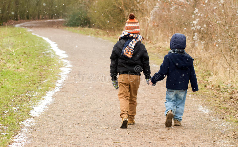 Brothers walking together along a country trail royalty free stock image