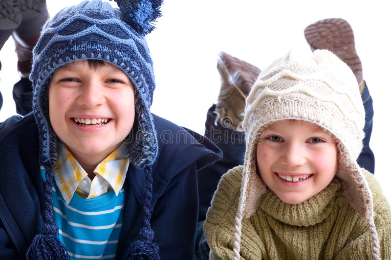 Brothers in winter attire stock photography
