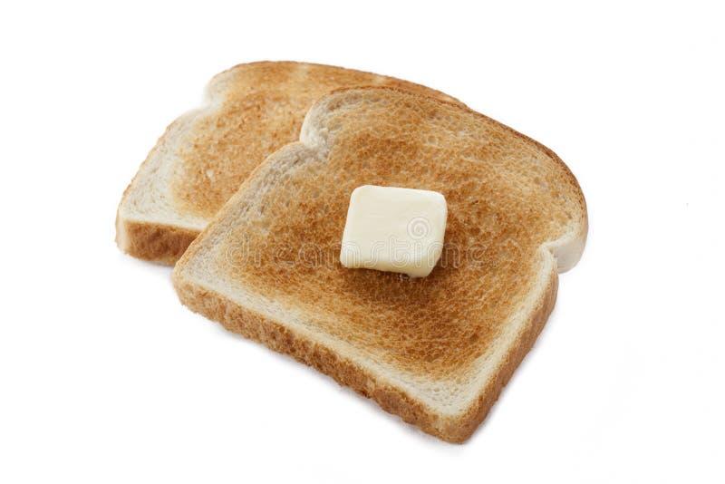 Brottoast mit Butter stockbild