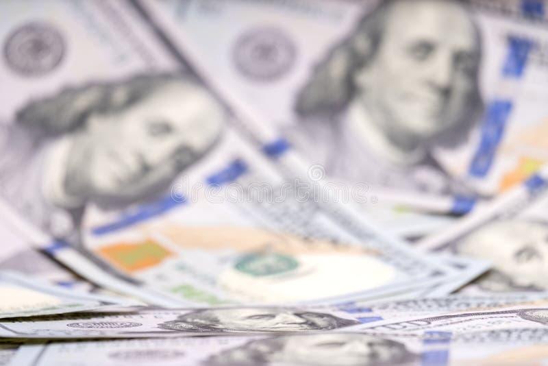 brouillé Fond plein de 100 dollars US Affaires et finances Profondeur du champ, DOF, foyer sélectif photo libre de droits