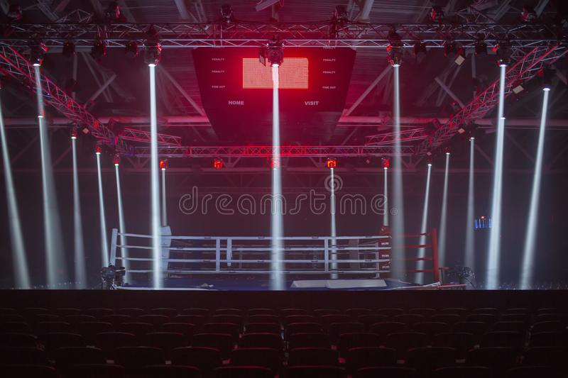 Brovary, Ukraine, 14.11.2015 boxing ring in low-light spotlights and red illumination from above. An electronic LED sports display is off. Close-up stock image