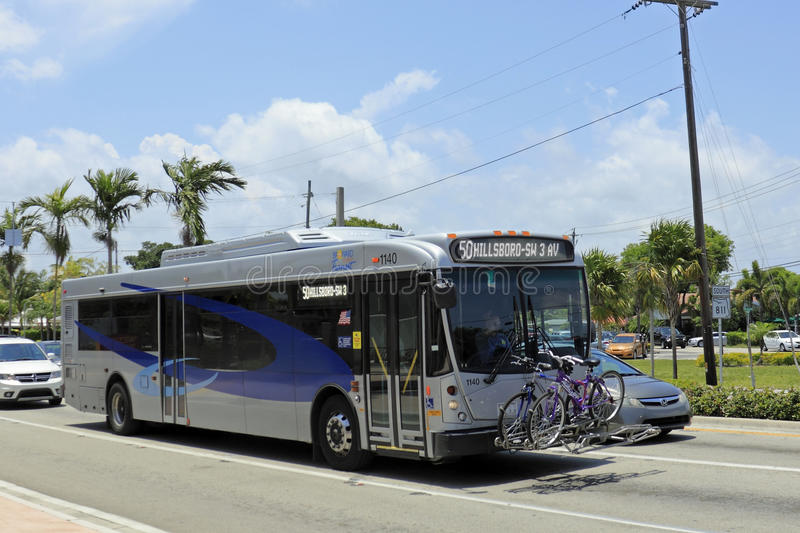 Broward County Transit Bus. WILTON MANORS, FLORIDA - MAY 11, 2013: Blue and gray silver public transportation with two bicycles securely stored on the front of royalty free stock photos