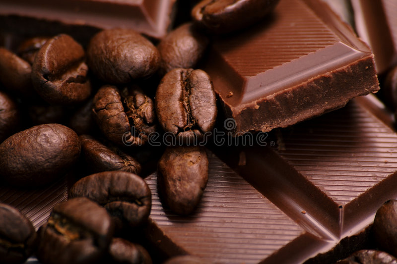 Brown. Chocolate-Coffee background: Close-up of a beans, cup, mill stock image