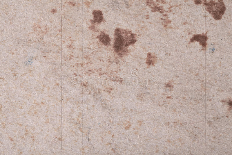 Brown abstract spots on textured fibrous paper or cardboard. Base for your ideas and projects royalty free stock image