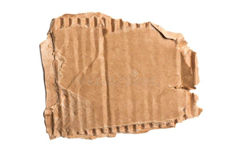 Brown acanaló el pedazo rasgado de la cartulina aislado en el fondo blanco foto de archivo libre de regalías