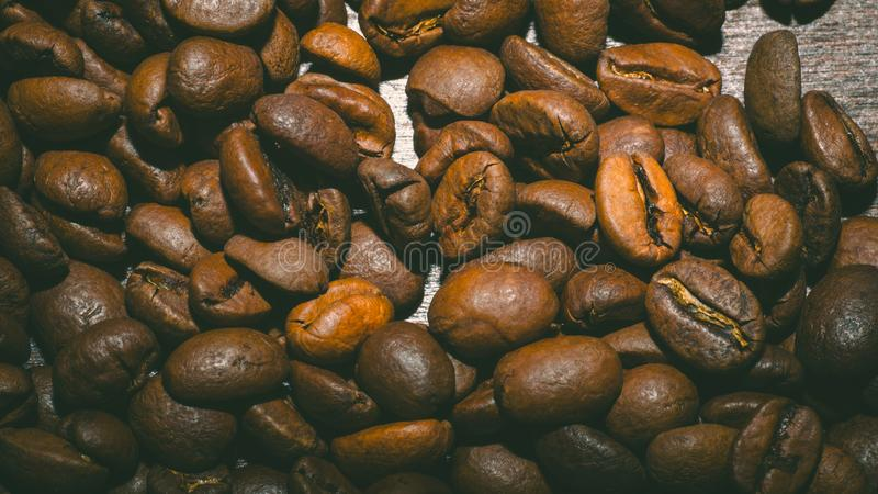 Brown coffee beans in the morning royalty free stock photos