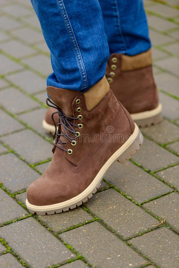 Brown autumn boots on men legs royalty free stock photos