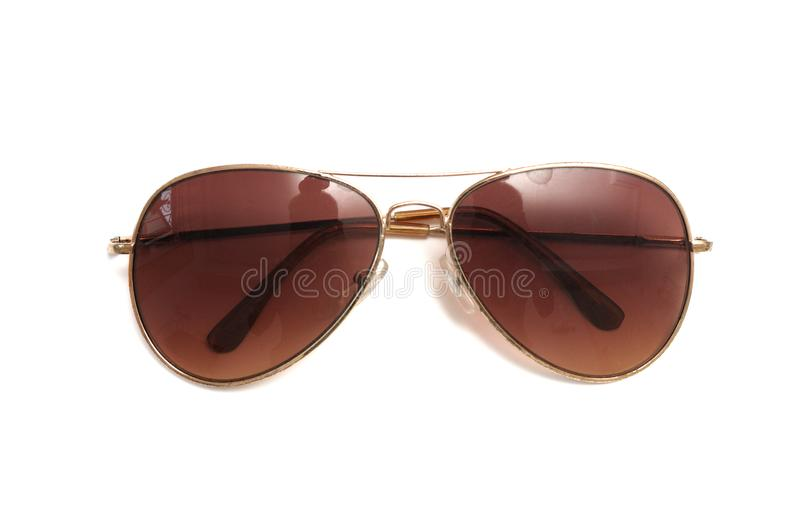 A brown aviator style sun shade glasses royalty free stock photography